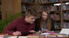 Two smiling students studying together using stock footage