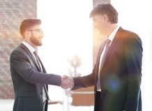 Businessmen shaking hands on business meeting in office royalty free stock photography