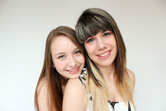 Two smiling teen girls. Two happy and smiling teen girls isolated on white Stock Photography