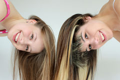 Two smiling teen girls having fun. Together with long hair Stock Photo