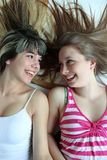 Two smiling teen girls having fun together Stock Photo
