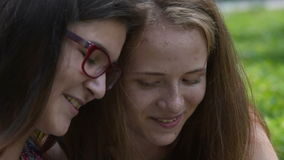 Two smiling teen girls outdoor stock footage