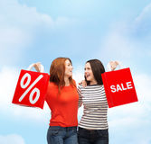Two smiling teenage girl with shopping bags Stock Image