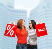 Two smiling teenage girl with shopping bags Royalty Free Stock Image