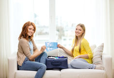 Two smiling teenage girls with plane tickets Royalty Free Stock Photos