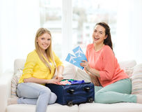 Two smiling teenage girls with plane tickets Royalty Free Stock Image