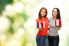Two smiling teenage girls with presents Royalty Free Stock Images