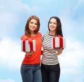 Two smiling teenage girls with presents Stock Photos