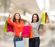 Two smiling teenage girls with shopping bags Royalty Free Stock Images