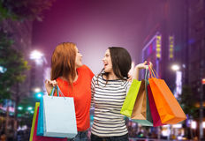 Two smiling teenage girls with shopping bags Royalty Free Stock Image
