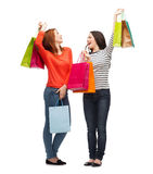 Two smiling teenage girls with shopping bags Royalty Free Stock Photography