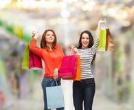 Two smiling teenage girls with shopping bags Stock Photography