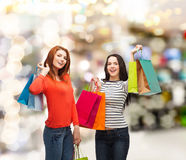 Two smiling teenage girls with shopping bags Royalty Free Stock Photo