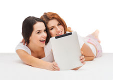 Two smiling teenage girls with tablet computer Royalty Free Stock Photography