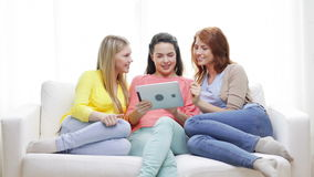 Two smiling teenage girls with tablet pc at home stock video footage