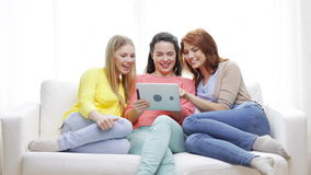 Two smiling teenage girls with tablet pc at home. Friendship, technology and internet concept - two smiling teenage girls with tablet pc computer at home stock footage