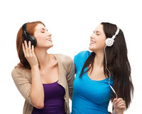 Two smiling teenagers with headphones Stock Image