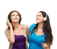 Two smiling teenagers with headphones Royalty Free Stock Images