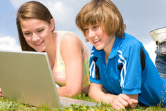 Two Smiling teenagers with laptop Stock Photo