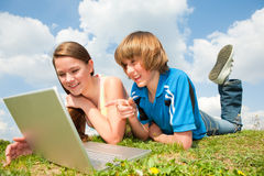 Two Smiling teenagers with laptop Stock Images