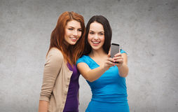 Two smiling teenagers with smartphone Stock Photo