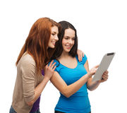 Two smiling teenagers with tablet pc computer Stock Image