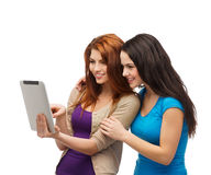 Two smiling teenagers with tablet pc computer Stock Images