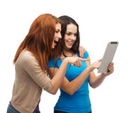 Two smiling teenagers with tablet pc computer Royalty Free Stock Image