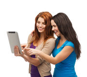 Two smiling teenagers with tablet pc computer Royalty Free Stock Photos