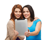 Two smiling teenagers with tablet pc computer Stock Photography