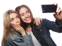 Two smiling teenagers taking picture Royalty Free Stock Photos
