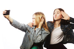 Two smiling teenagers taking picture Royalty Free Stock Images