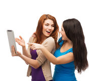 Two smiling teenages with tablet pc computer Royalty Free Stock Image