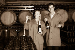 Two smiling winery employees in aging section in cellar Royalty Free Stock Photo