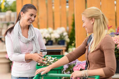 Two smiling woman shopping plants garden center Royalty Free Stock Image