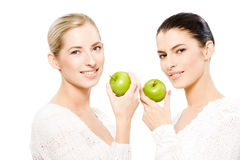 Two smiling women with apples royalty free stock photography