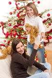 Two smiling women with Christmas decoration Royalty Free Stock Photo