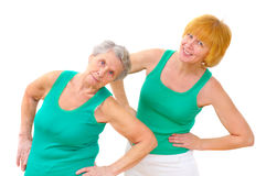 Two smiling women doing gymnastics Stock Photo