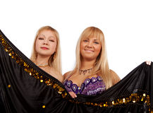 Two smiling women hiding Royalty Free Stock Photography