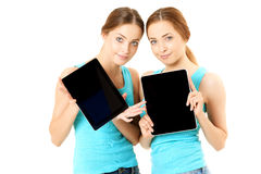 Two smiling women holding tablet computer royalty free stock photos