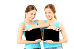 Two smiling women holding tablet computer Stock Photo