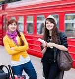Two women are near the train Royalty Free Stock Photo