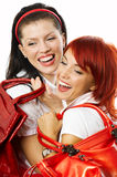 Two smiling women with red handbags Stock Image