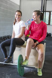 Two smiling women rests at fitness gym center Royalty Free Stock Photo