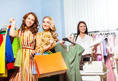 Two smiling women,shop assistant together Stock Photo