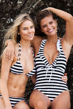 Two Smiling Women Wearing Striped Swimsuits Stock Photos