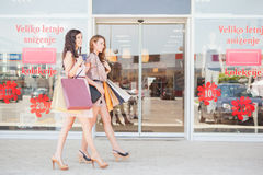 Two Smiling Women Window Shopping Stock Photography