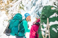 Two smiling women in a winter hike royalty free stock photos