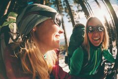 Two smiling women in a winter hike stock photo