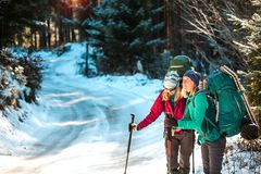Two smiling women in a winter hike stock images